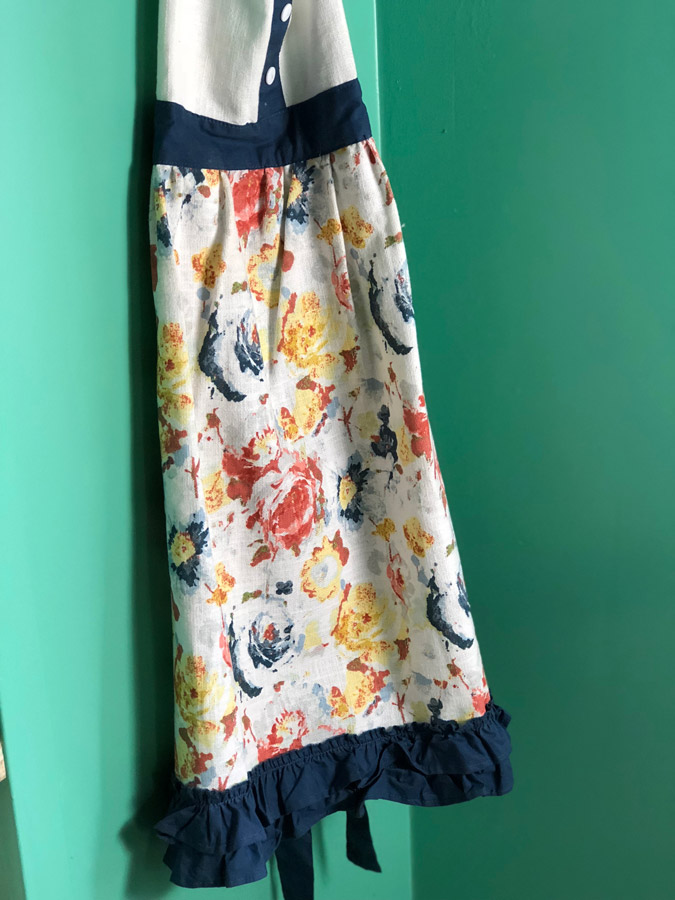 A baking apron hangs in a butler's pantry.