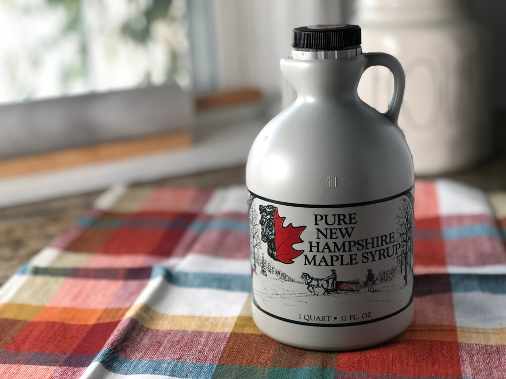 Pure New Hampshire maple syrup is on display for a mini apple bundt cake recipe.