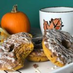A plate of three baked pumpkin streusel donuts.