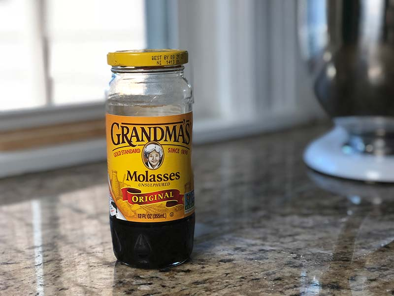 Molasses is on display and used in this pumpkin frosting recipe.