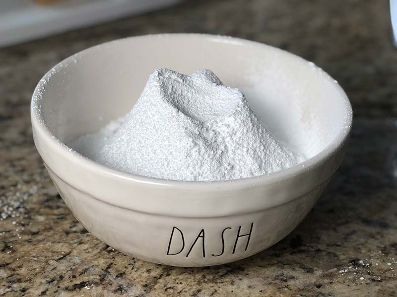 3 cups of sifted flour sits in a medium-sized mixing bowl.