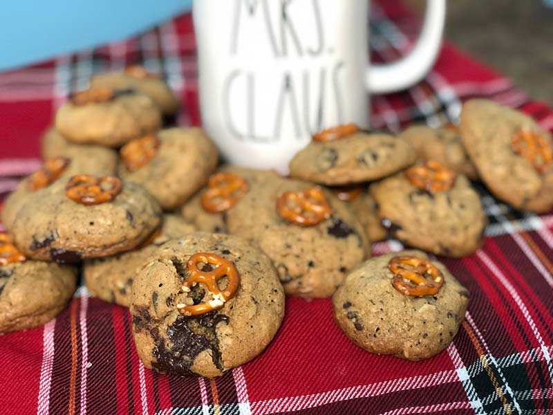Compost cookies are served with hot chocolate in a Rae Dunn Christmas mug.