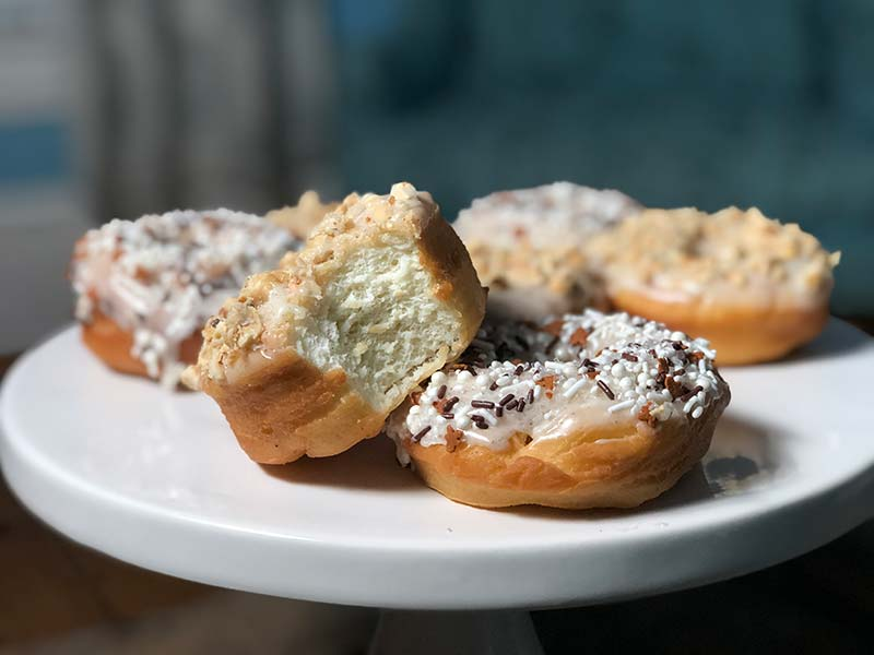 The inside of a cardamom donut from this recipe is shown.