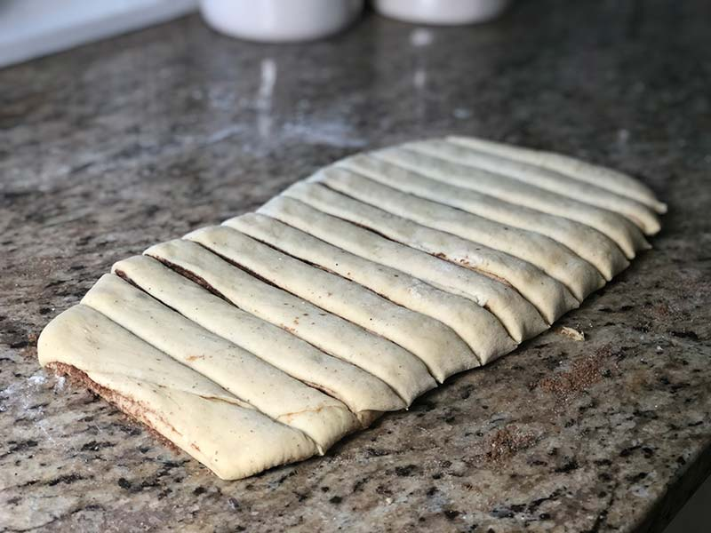 The dough for the Swedish cinnamon buns has been cut into strips.