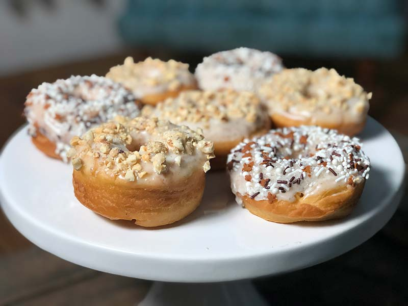 A plate of cardamom donuts is displayed.