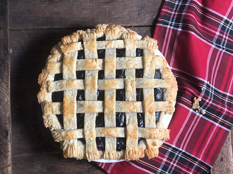 A blueberry raspberry pie hot out of the oven.