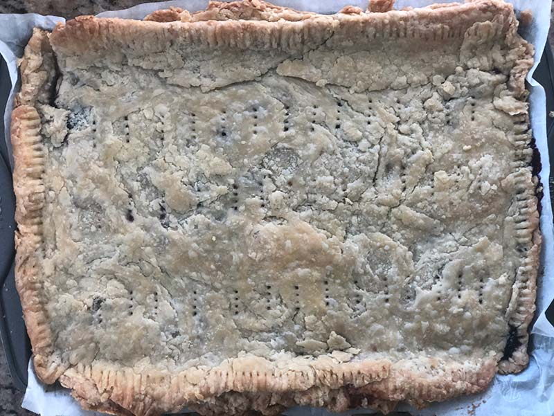 This giant blueberry Pop-Tart slab pie is done baking and now needs to cool for 20 minutes.