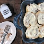 Maple pecan cinnamon rolls with cream cheese frosting fresh out of the oven.